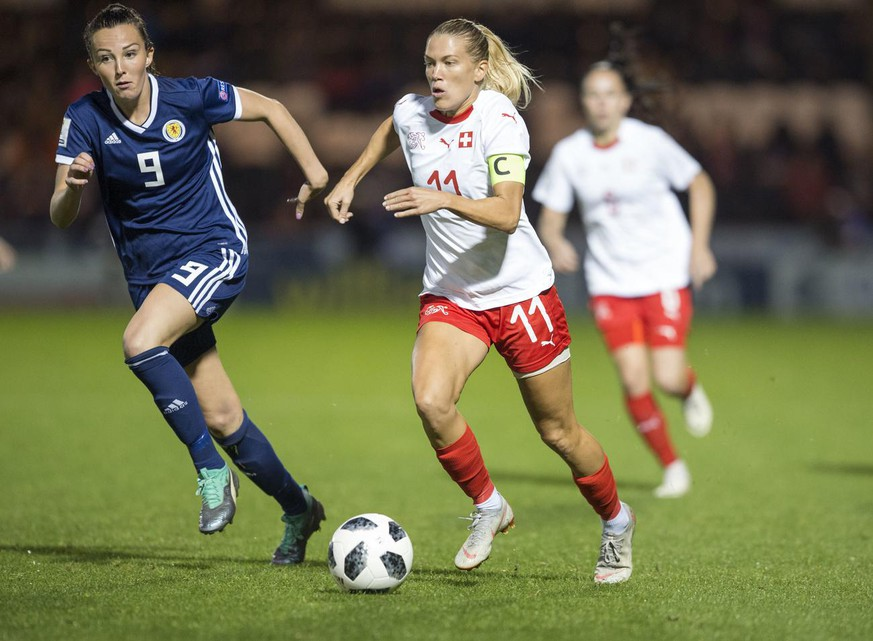 Lara Dickenmann of Switzerland (11) goes past Caroline Weir (9) of Scotland during the FIFA Women's World Cup 2019 Qualification Round – Group 2 Game: Scotland v Switzerland at Saint Mirren Park on Thursday, Aug 30, 2018 in Paisley, Scotland. (Ian Rutherford/AP Images for Keystone)
