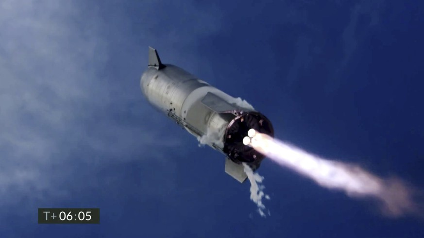 In this image from video made available by SpaceX, one of the company's Starship prototypes fires its thrusters as it lands during a test in Boca Chica, Texas, on Wednesday, March 3, 2021. The two previous attempts ended in explosions. (SpaceX via AP)