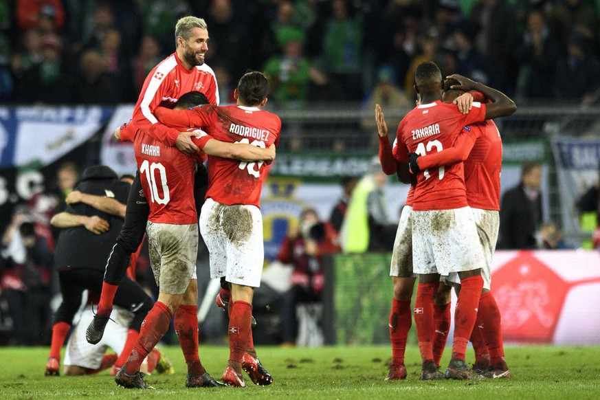 Switzerland's national team soccer players celebrate their qualifying for the 2018 FIFA World Cup Russia after beating Northern Ireland, during the 2018 Fifa World Cup play-offs second leg soccer match Switzerland against Northern Ireland at the St. Jakob-Park stadium in Basel, Switzerland, Sunday, November 12, 2017. (KEYSTONE/Laurent Gillieron)