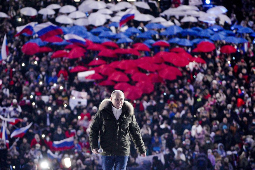 Russian President Vladimir Putin arrives to attend a concert marking the seventh anniversary of the referendum on the state status of Crimea and Sevastopol and its reunification with Russia, in Moscow, Russia, Thursday, March 18, 2021. (Alexei Druzhinin, Sputnik, Kremlin Pool Photo via AP)