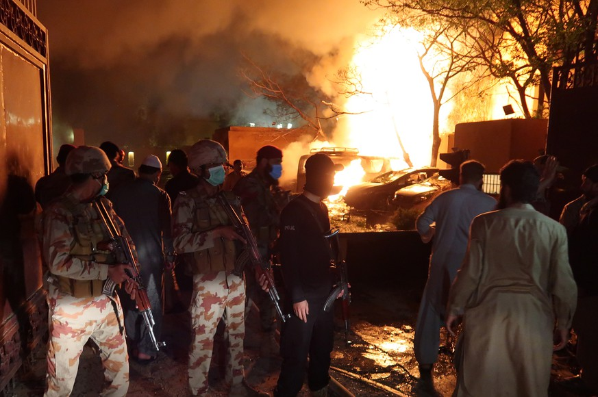 epa09151129 Flames rise from inside the Serena hotel after a bomb blast in Quetta, provincial capital of Balochistan province, Pakistan, 21 April 2021. A bomb exploded at a parking lot of Serena hotel where a foreign delegation believed to be from China, was staying, killing three people while leaving 11 others injured. According to Pakistan's Interior Minister the members of the foreign delegation, who have been staying at the hotel were not there at the time of the blast and are all safe.  EPA/FAYYAZ AHMED