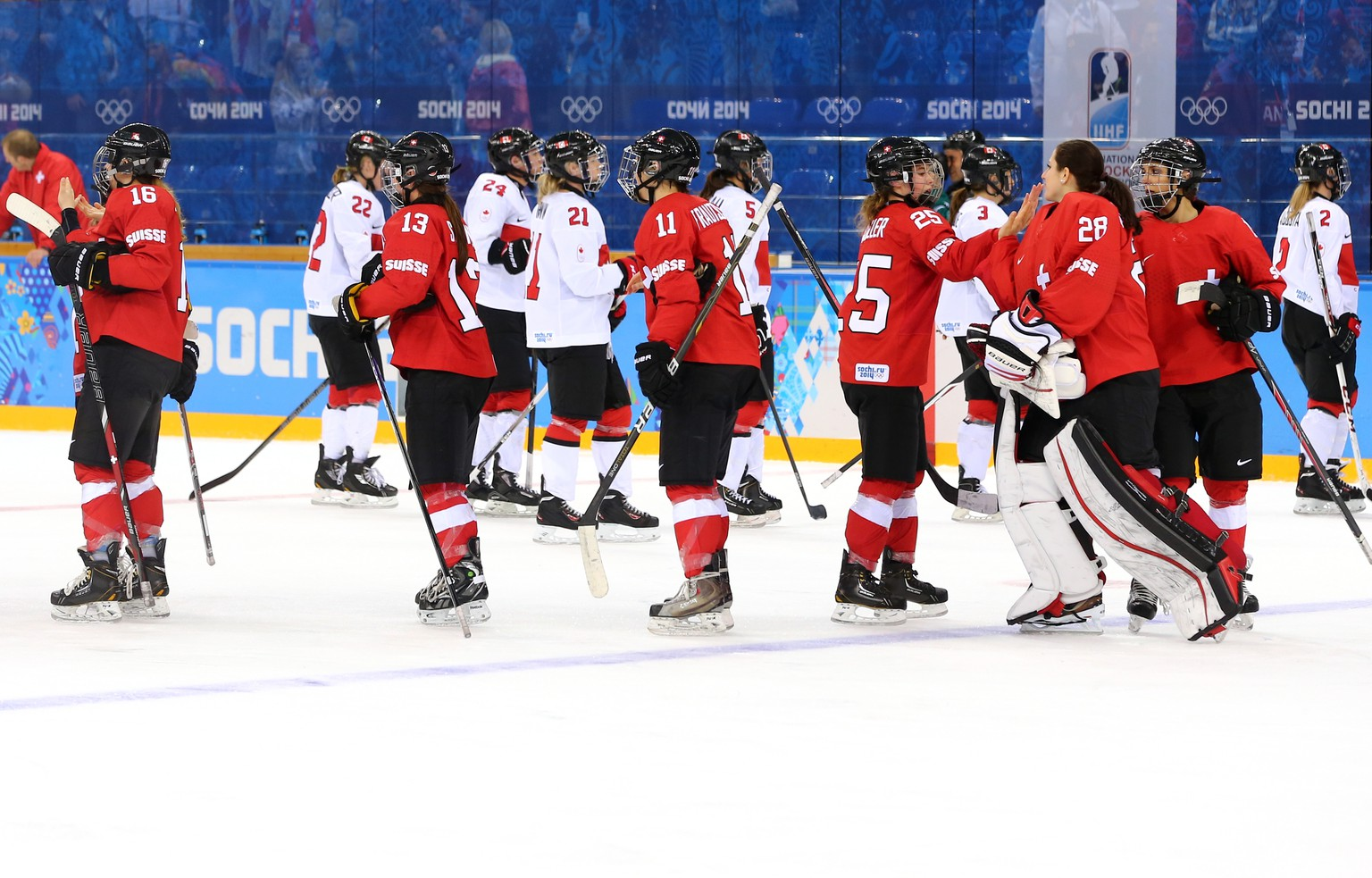 SOCHI, RUSSIA - FEBRUARY 17:  Canadian and Swiss players shake hands after Canada defeated Switzerland 3-1 during the Women's Ice Hockey Playoffs Semifinal game on day ten of the Sochi 2014 Winter Olympics at Shayba Arena on February 17, 2014 in Sochi, Russia.  (Photo by Martin Rose/Getty Images)