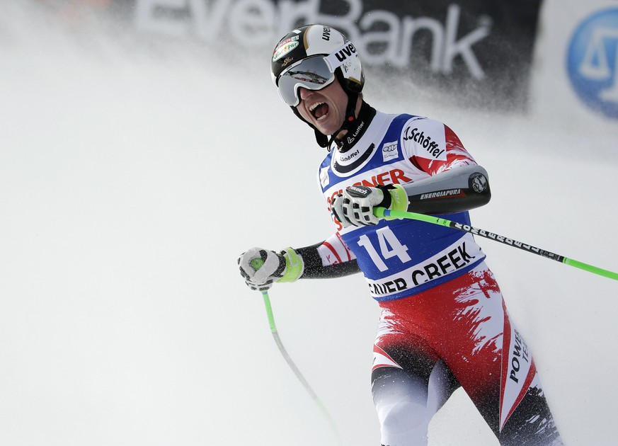 Hannes Reichelt, of Austria, reacts after finishing his run in the men's World Cup super-G ski race Saturday, Dec. 6, 2014, in Beaver Creek, Colo. (AP Photo/John Locher)