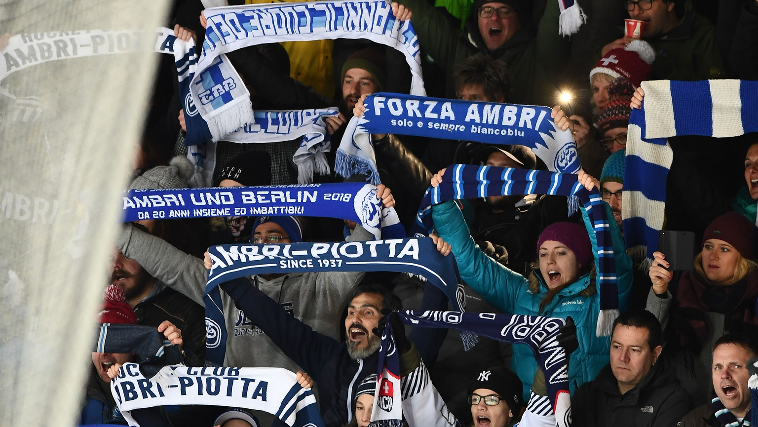 Ambri''s fans celebrate victory at the end of the preliminary round game of National League Swiss Championship 2018/19 between HC Ambri Piotta and SCL Tigers, at the Valascia Stadium in Ambri, Switzerland, Saturday, January 05, 2019. (KEYSTONE/Ti-Press/Samuel Golay)