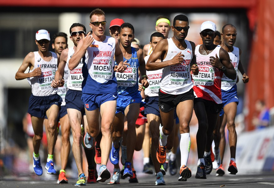 Norway's Sondre Nordstad Moen, Italy's Yassine Rachik, Switzerland's Tadesse Abraham and Austria's Lemawork Ketema, from left, compete in the men's marathon at the European Athletics Championships in downtown Berlin, Germany, Sunday, Aug. 12, 2018. (AP Photo/Martin Meissner)