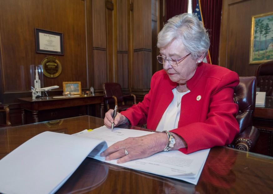epa07574055 A handout photo made available by Alabama Governor Office shows Governor Kay Ivey signing into law the Alabama Human Life Protection Act, Montgomery, Alabama, USA, 15 May 2019. Alabama's controversial Human Life Protection Act is an abortion ban except when abortion is necessary in order to prevent a serious health risk to the woman, according to the Act's text, as well criminalizing the abortion procedure into a Class A felony, with attempted abortion classified as Class C penalty.  EPA/ALABAMA GOVERNOR OFFICE HANDOUT  HANDOUT EDITORIAL USE ONLY/NO SALES