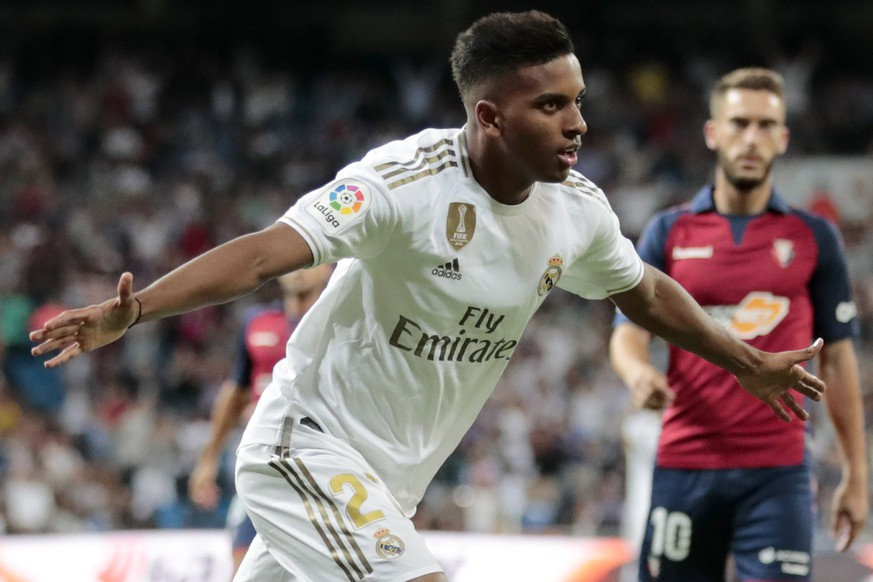 Real Madrid's Rodrygo celebrates scoring his side's 2nd goal, during the Spanish La Liga soccer match between Real Madrid and Osasuna at the Santiago Bernabeu stadium in Madrid, Spain, Wednesday, Sept. 25, 2019. (AP Photo/Bernat Armangue) Rodrygo