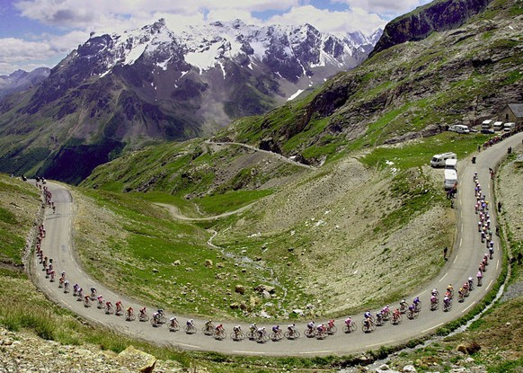 ADVANCE FOR WEEKEND EDITIONS, JUNE 22-23 - FILE - In this July 16, 2000 file photo, the pack climbs the Galibier pass during the 15th stage of the Tour de France cycling race between Briancon and Courchevel, French Alps. The Tour de France, which starts next Saturday, June 29, 2013, remains a fantastic idea, not old even as it is put into practice for the 100th time. Asking riders to pedal around Western Europe's largest country and up and down some of its tallest mountains for three weeks is zany and whimsical enough to always be interesting. But is the Tour still worth taking seriously as a sports event? (AP Photo/Christophe Ena, File)
