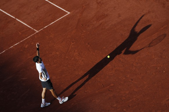 Serbia's Novak Djokovic plays gestures in his fourth round match against Spain's Albert Ramos-Vinolas at the French Open tennis tournament at the Roland Garros stadium, in Paris, France. Sunday, June 4, 2017. (AP Photo/Christophe Ena)