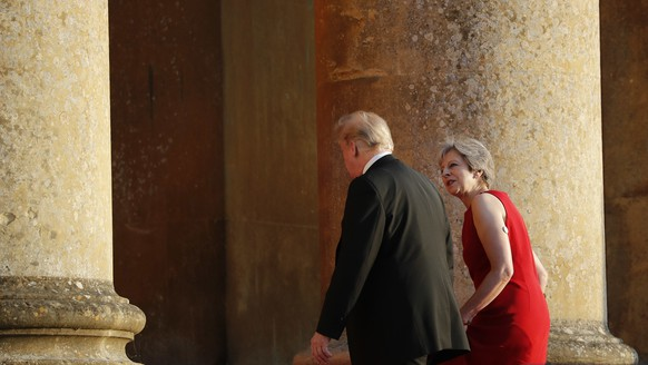 British Prime Minister Theresa May, right, talks with President Donald Trump, left, as they walk into Blenheim Palace, Oxfordshire, where May will host a dinner as part of Trump's visit to the United Kingdom, Thursday, July 12, 2018. (AP Photo/Pablo Martinez Monsivais)