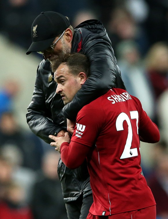 epa07547670 Liverpool's manager Juergen Klopp hugs Xhredan Shaqiri (R) after winning the English Premier League soccer match between Newcastle United and Liverpool FC at St James' Park in Newcastle, Britain, 04 May 2019.  EPA/NIGEL RODDIS EDITORIAL USE ONLY. No use with unauthorized audio, video, data, fixture lists, club/league logos or 'live' services. Online in-match use limited to 120 images, no video emulation. No use in betting, games or single club/league/player publications
