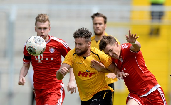 MUNICH, GERMANY - JUNE 01: Kevin Friesenbichler (from L) of Muenchen, Jan-Andre Sievers of Koeln and Tobias Schweinsteiger of Muenchen compete for the ball during the second relegation leg between Bayern Muenchen II and Fortuna Koeln at Stadion An Der Gruenwalder Strasse on June 1, 2014 in Munich, Germany.  (Photo by Micha Will/Bongarts/Getty Images)
