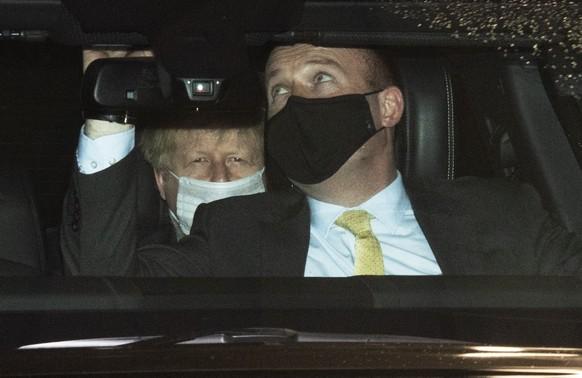 epa08916290 British Prime Minister Boris Johnson (L) leaves the Andrew Marr show in the BBC studios in London, Britain, 03 January 2021.  EPA/FACUNDO ARRIZABALAGA