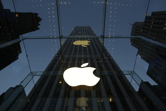 FILE - In this Wednesday, Nov. 20, 2013, file photo, the Apple logo is illuminated in the entrance to the Fifth Avenue Apple store, in New York. Six weeks ago, the iPhone and iPad maker announced plans to split its stock for the first time in nine years. Since then, Apple's shares have surged more than 20 percent. The stock split helped renew investor interest in Apple Inc., already the world's most valuable company. (AP Photo/Mark Lennihan, File)