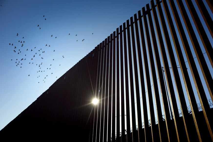 epa07743520 (FILE) - Birds fly over a section of the recently renovated US-Mexico border wall, in Calexico, California, USA, on 26 October 2018, (reissued 27 July 2019). According to media reports on 27 July 2019 state  that the US Supreme Court has said that President Donald J. Trump can use 2.5 billion US dollars or 2.24 billion euros of Pentagon funds for a section of wall on the southern border projects in California, Arizona and New Mexico.  EPA/David Maung *** Local Caption *** 54995156