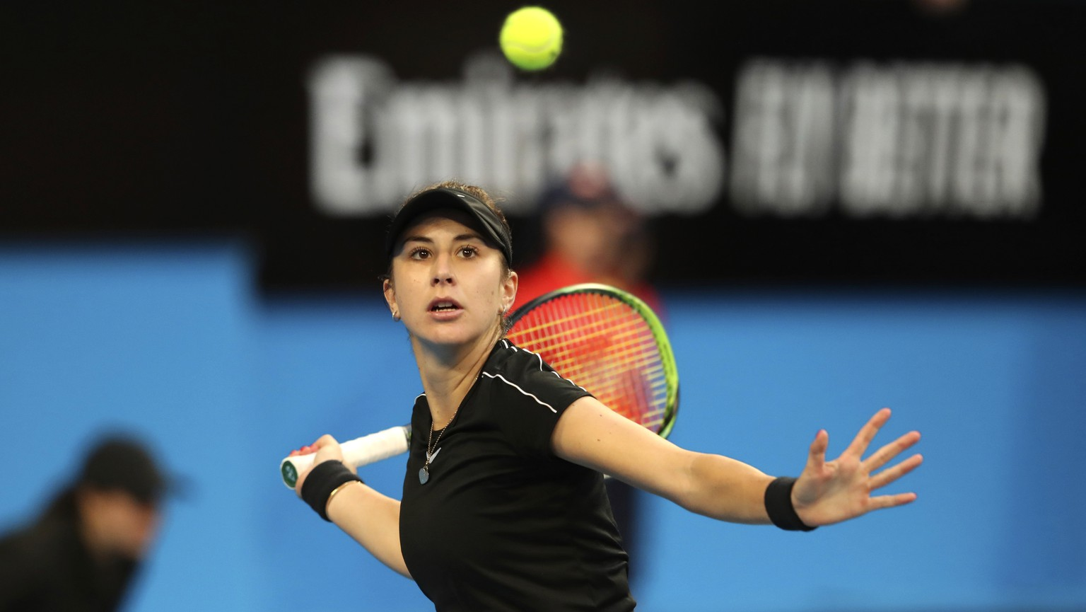 Switzerland's Belinda Bencic plays a shot during her match against Angelique Kerber of Germany in the final of the Hopman Cup tennis tournament in Perth, Australia, Saturday Jan. 5, 2019. (AP Photo/Trevor Collens)