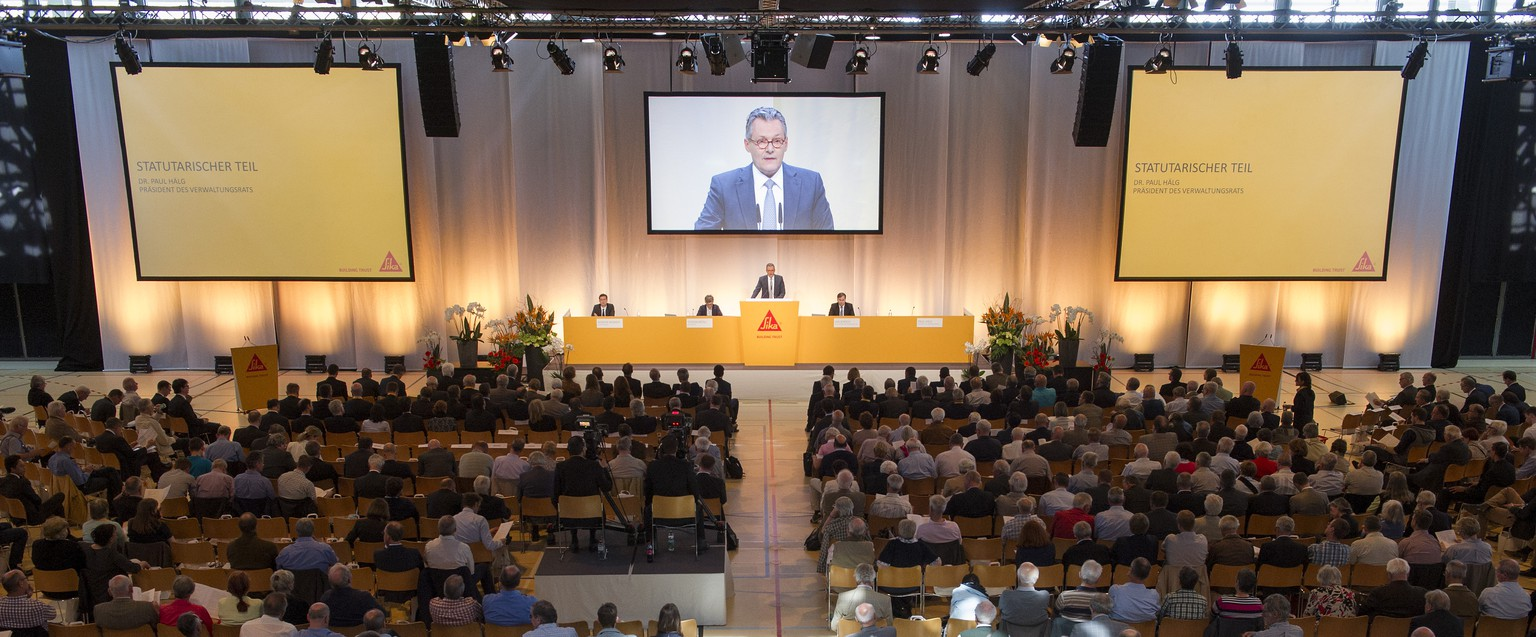 A general view of the Annual General Meeting 2015 of Sika in Baar, Switzerland, Tuesday, April 14, 2015. The Management and the Board of Directors is still firmly opposed to the project of Schenker-Winkler Holding (SWH) to cede control of the French group Saint-Gobain. SWH represents the interests of the Burkard family, descendents of Sika's founder. (KEYSTONE/Anthony Anex)