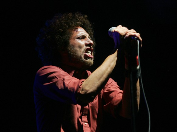 Zack de la Rocha of Rage Against The Machine's  performs at the Coachella Valley Music and Arts Festival in Indio, Calif., on Sunday, April 29, 2007. (AP Photo/Branimir Kvartuc)