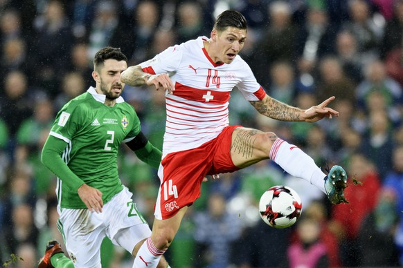 Northern Ireland's defender Conor McLaughlin, left, fights for the ball with Switzerland's midfielder Steven Zuber, right, during the 2018 Fifa World Cup play-offs first leg soccer match Northern Ireland against Switzerland at Windsor Park, in Belfast, Northern Ireland, Britain, Thursday, November 9, 2017. (KEYSTONE/Laurent Gillieron)