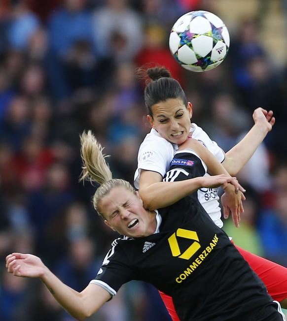Paris St Germain's Aurelie Kaci fights for the ball with FFC Frankfurt's Ana Maria Crnogorcevic (L) during their UEFA Women's Champions League final soccer match in Berlin, Germany, May 14, 2015.    REUTERS/Axel Schmidt  TPX IMAGES OF THE DAY