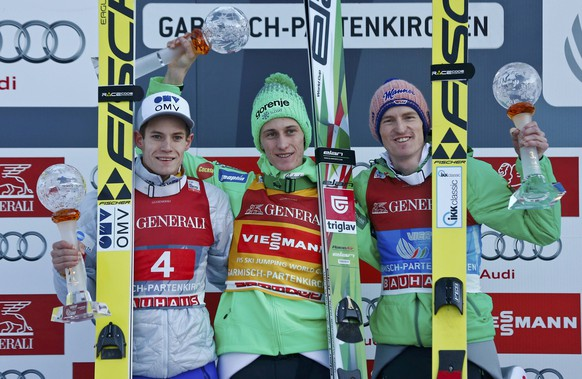 Kenneth Gangnes of Norway, Peter Prevc of Slovenia and Severin Freund of Germany (L-R) react after the second jumping of the 64th four-hills ski jumping tournament in Garmisch-Partenkirchen, southern Germany, January 1, 2016.   REUTERS/Michael Dalder