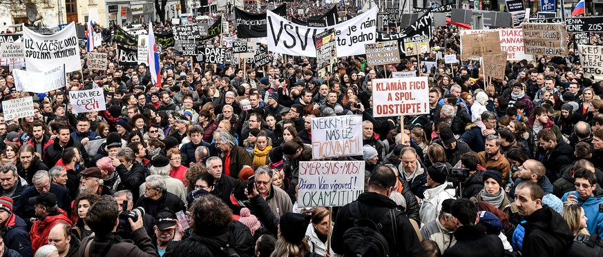 epa06608365 People participate in a rally called 'Let's stand for decency in Slovakia' in Bratislava, Slovakia, 16 March 2018. Mass street protests started after the murder of journalist Jan Kuciak and his fiance Martina Kusnirova. Protesters are asking for an independent investigation into the murders of Kuciak and his fiancee and a new, trustworthy government that will not include people suspected of corruption.  EPA/CHRISTIAN BRUNA