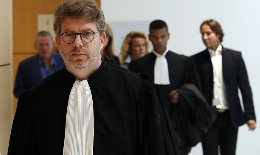 Lawyer of Saudi princess Hassa bint Salman, Emmanuel Moyne, arrives at courthouse in Paris, Thursday, Sept. 12, 2019. The only daughter of Saudi Arabia's King Salman has been found guilty by a Paris court of charges that she ordered her bodyguard to detain and strike a plumber for taking photos at the Saudi royal family's apartment in the French capital. (AP Photo/Thibault Camus)