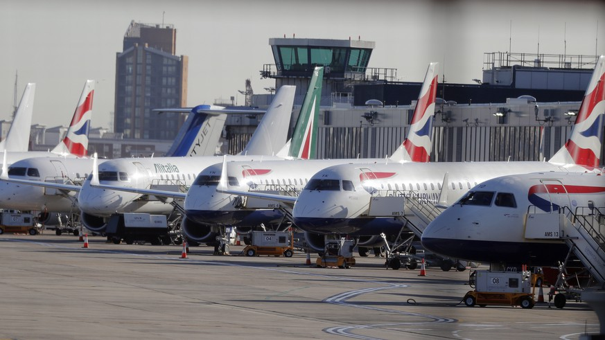 Airplanes are parked at London City Airport in London, Monday, Feb. 12, 2018. London City Airport is closed all day due to a WWII unexploded bomb. Cancellations are expected at London City Airport after an unexploded World War II bomb was uncovered nearby. The device was found at George V Dock during work at London City Airport.(AP Photo/Frank Augstein)