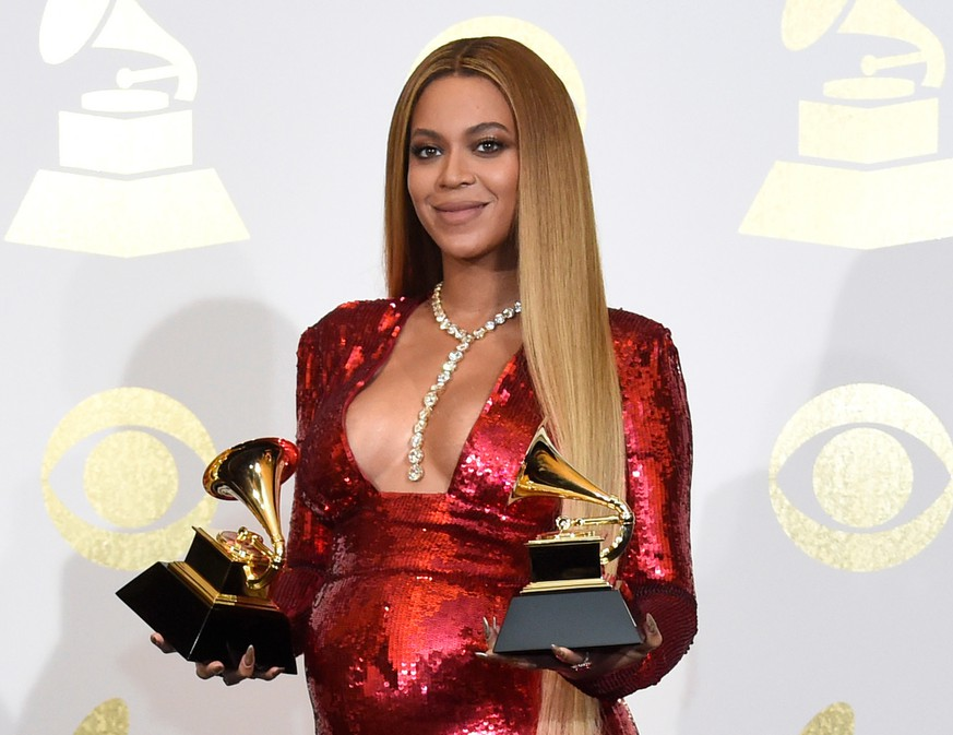 FILE - In this Feb. 12, 2017 file photo, Beyonce poses in the press room with the awards for best music video for