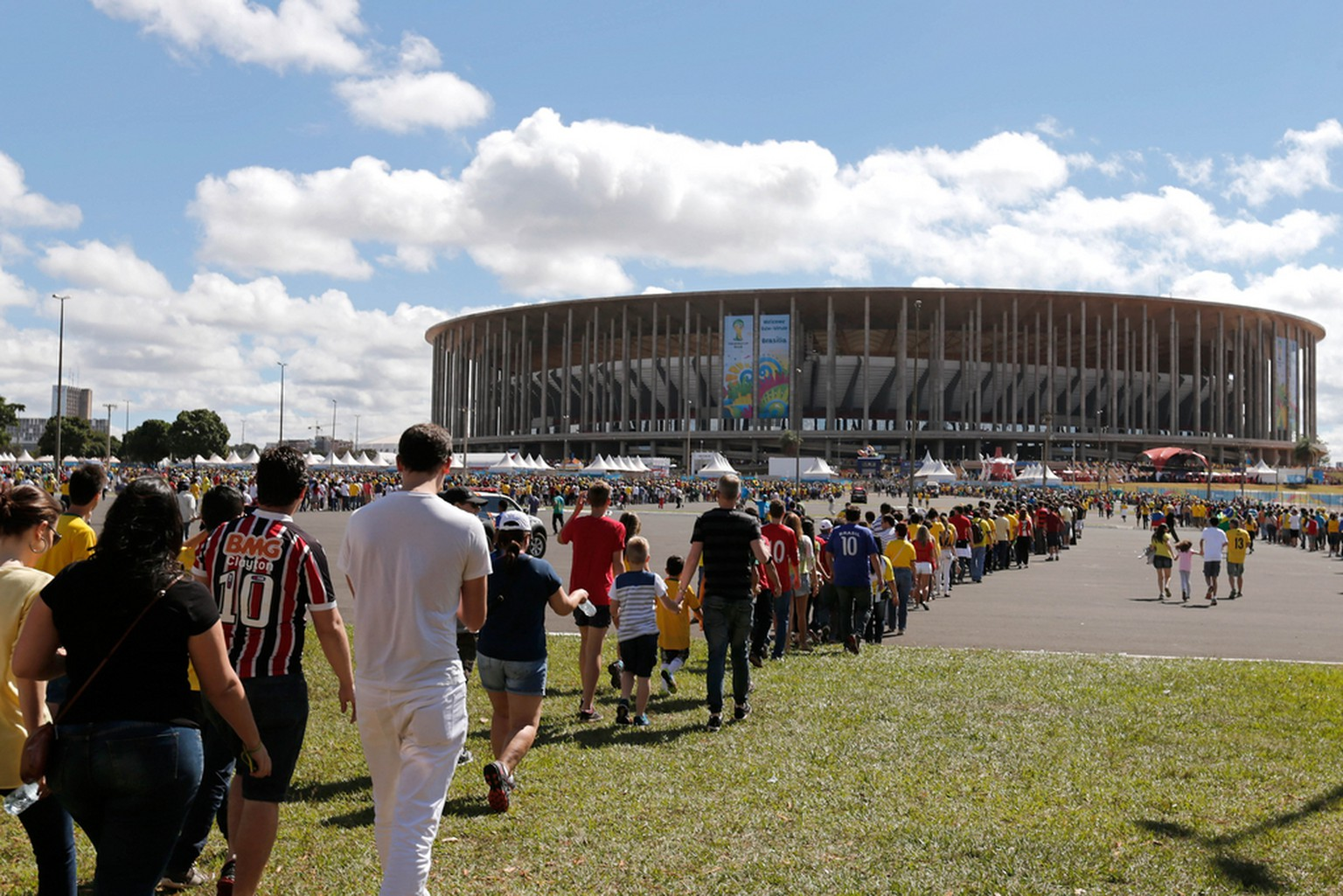 Fans waiting in long lines advance slowly to enter the National Stadium before the start of the match between Ecuador vs Switzerland, in Brasilia, Brazil, Sunday, June 15, 2014. (AP Photo/Eraldo Peres)
