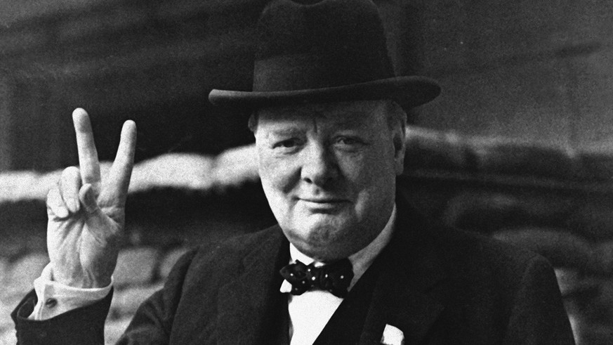FILE - This is a Aug. 27, 1941  file photo of British Prime Minister Winston Churchill as he gives his famous