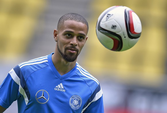 Germany's Sidney Sam exercises during a training session at the stadium in Dortmund, Germany,  prior the UEFA EURO 2016 qualifying soccer match between Germany and Scotland, Saturday, Sept. 6, 2014. (AP Photo/Martin Meissner)