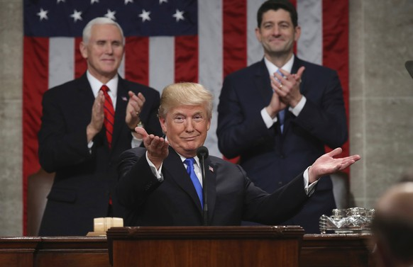 """FILE - In this Jan. 30, 2018, file photo, President Donald Trump gestures as delivers his first State of the Union address in the House chamber of the U.S. Capitol to a joint session of Congress in Washington, as Vice President Mike Pence and House Speaker Paul Ryan applaud. Less than a week ago, Trump stood before the nation and called for a new era of bipartisan cooperation. """"Tonight, I call upon all of us to set aside our differences, to seek out common ground, and to summon the unity we need to deliver for the people we were elected to serve,"""" he said, extolling how the country had come together in recent times of tragedy. A week later, such talk is but a distant memory. (Win McNamee/Pool via AP, File)"""