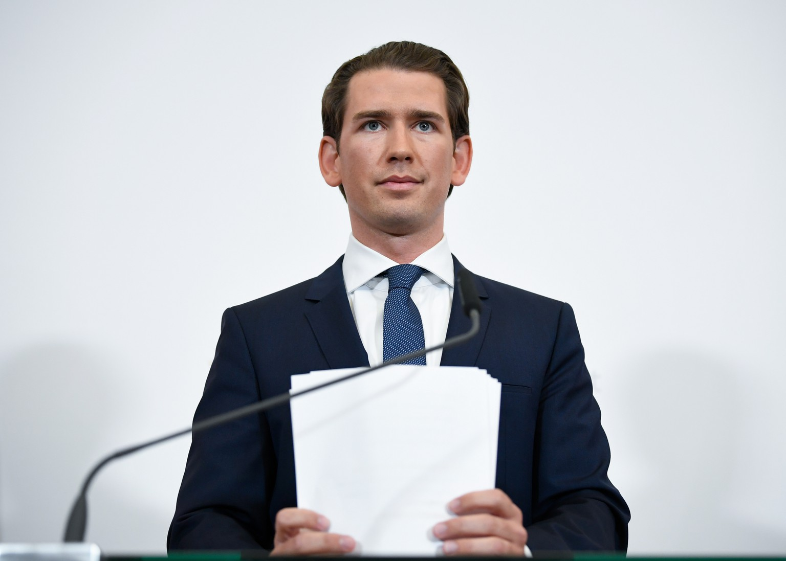 epa07582303 Austrian Chancellor Sebastian Kurz holds his speech manuscript after announcing new elections in Austria on a statement in Vienna, Austria, 18 May 2019. Austrian Vice Chancellor Strache on 18 May 2019 said he will step down from his post as media caught the far-right FPOe's leader Strache in a corruption allegations scandal. German magazine 'Der Spiegel' and newspaper 'Sueddeutsche Zeitung' published on 17 May 2019 a secretly recorded video which appeared to show Strache in Ibiza, Spain, in July 2017, meeting an alleged niece of a unknown Russian oligarch who wanted to invest large sums of money in Austria. In return for election campaign donations, Strache is alleged to have promised public contracts in the event of his party joining the government.  EPA/CHRISTIAN BRUNA