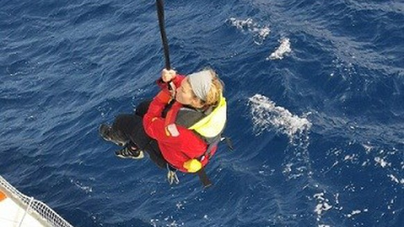 epa07215335 A handout photo made available by the Chilean Navy shows English yachtswoman Susie Goodall as she is rescued by a cargo ship at sea, west of Cape Horn, Chile, 07 December 2018. Susie Goodall was rescued safe and sound thanks to the coordination of the Maritime Rescue Coordination Centre of the Chilean Navy (MRCC CHILE) after her yacht DHL Starlight capsized on 05 December 2018  about 2000 miles west of Cape Horn during the Golden Globe Race 2018.  EPA/CHILEAN NAVY HANDOUT BEST QUALITY AVAILABLE HANDOUT EDITORIAL USE ONLY/NO SALES