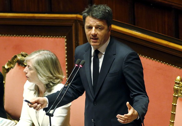 Italian Prime Minister Matteo Renzi gestures as he speaks at the Senate in Rome, April 22, 2015. The European Union must take a collective stand to tackle migrant trafficking at its source in African countries, Prime Minister Matteo Renzi said on Wednesday. REUTERS/Remo Casilli