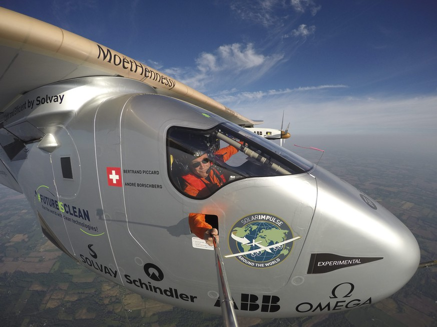 epa05329379 A handout picture made available on 26 May 2016 shows Swiss adventurer and pilot Bertrand Piccard talking an extreme self portait during the flight of Solar Impulse 2 (Si2) to Lehigh Valley, Pennsylvania, USA, 25 May 2016. Solar Impulse successfully landed in Lehigh Valley with Bertrand Piccard at the controls after 17 hours of flight. Departed from Abu Dhabi on 09 March 2015, the Round-the-World Solar Flight will take 500 flight hours and cover 35,000 kilometers.  EPA/SOLAR IMPULSE/REZO/HANDOUT  HANDOUT EDITORIAL USE ONLY/NO SALES