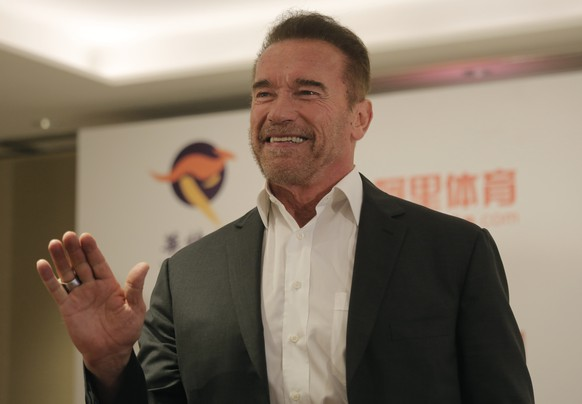 Former California governor, actor and co-founder of Arnold Classic, Arnold Schwarzenegger poses for photographers during a press conference of the Arnold Classic Asia Multi-Sport Festival in Hong Kong, Friday, Aug. 19, 2016. Schwarzenegger is currently promoting the first time sports festival 'Arnold Classics' in Asia. (AP Photo/Vincent Yu)