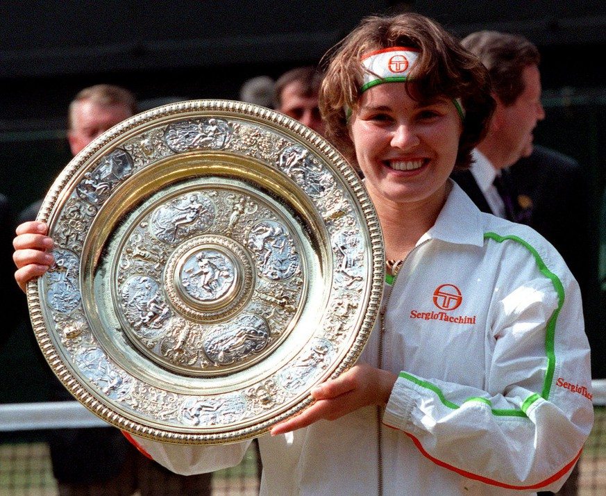 Martina Hingis holds her trophy, after defeating Jana Novotna in the Women's Singles final on the Centre Court at Wimbledon,  July 5, 1997. Hingis won the final 2-6, 6-3, 6-3, to become the youngest winner of the championship this century. Martina Hingis said Thursday Nov. 1, 2007  she has been accused of testing positive for cocaine at Wimbledon, and announced her retirement from professional tennis.  Hingis, a five-time Grand Slam champion and former Wimbledon winner, denied using cocaine. (AP Photo/File/Dave Caulkin)