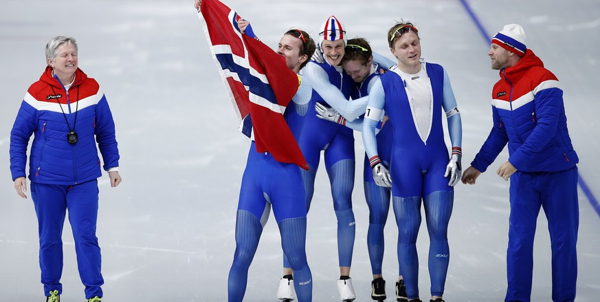 Gold medalist team Norway with Havard Bokko, Sindre Henriksen, Simen Spieler Nilsen and Sverre Lunde Pedersen celebrate with their coaches after the men's team pursuit final speedskating race at the Gangneung Oval at the 2018 Winter Olympics in Gangneung, South Korea, Wednesday, Feb. 21, 2018. (AP Photo/Vadim Ghirda)