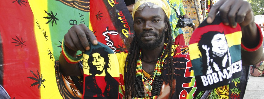 epa07197390 (FILE) - A member of the group Ivoire Binghi displays reggae clothing during the second edition of the International Festival of Abidjan Reggae know as Abi-Reggae at the Palace of Culture in Abidjan, Ivory Coast 07 April 2016 (reissued 29 November 2018). According to media reports Reggae was added to UNESCO cultural heritage list as declared on 29 November 2018.  EPA/LEGNAN KOULA *** Local Caption *** 52689452