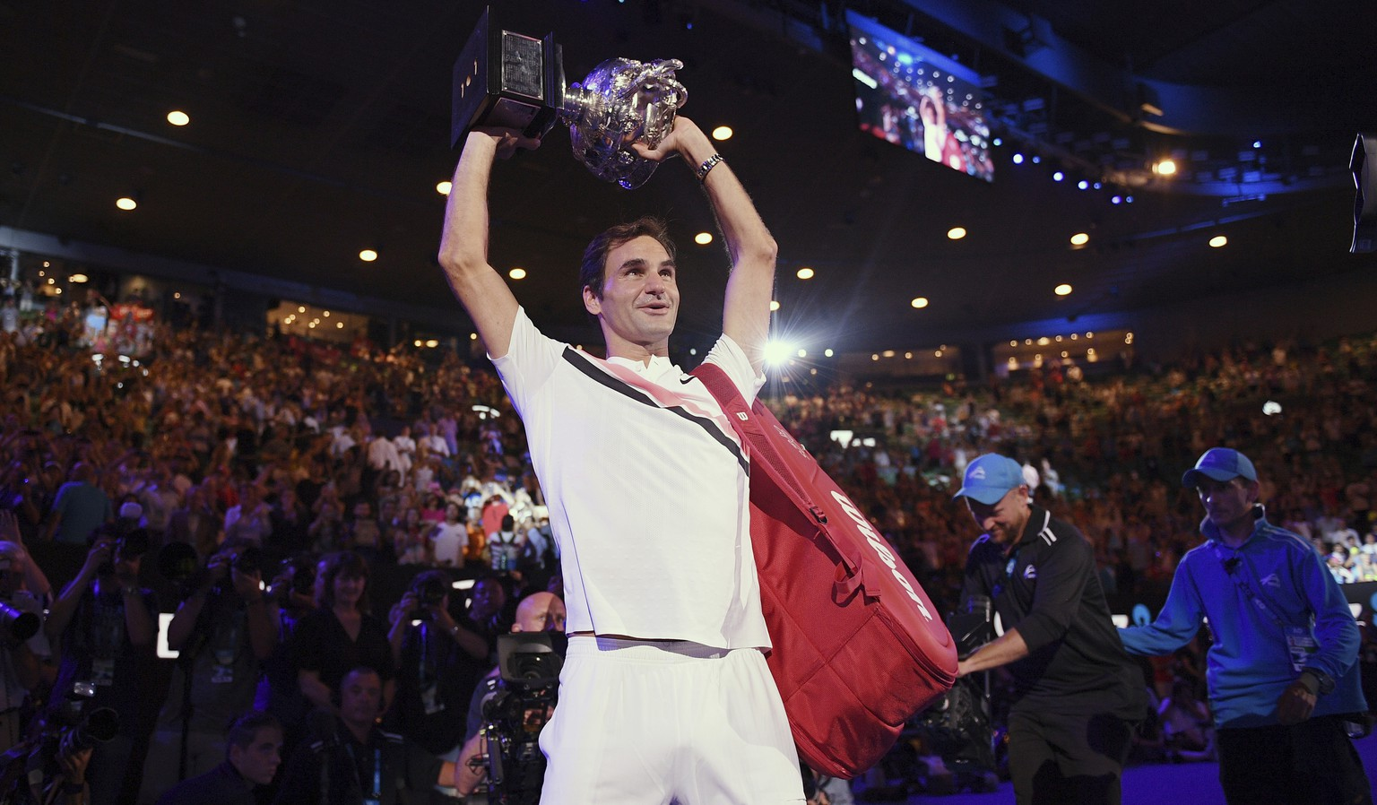 Switzerland's Roger Federer holds his trophy aloft after defeating Croatia's Marin Cilic in the men's singles final at the Australian Open tennis championships in Melbourne, Australia, Sunday, Jan. 28, 2018. (AP Photo/Andy Brownbill)