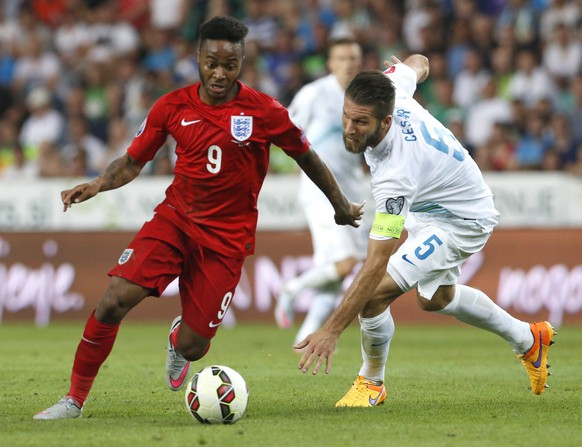 epa04799483 England's Raheem Sterling  (L) in action against Slovenian's Bostjan Cesar (R)  during the UEFA EURO 2016 qualification soccer match between Slovenia and England in Ljubljana, Slovenia, 14 June   2015.  EPA/ANTONIO BAT
