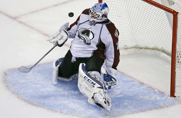 Colorado Avalanche goalie Reto Berra makes a save against the Boston Bruins in the third period of an NHL hockey game in Boston, Monday, Oct. 13, 2014. The Avalanche won 2-1. (AP Photo/Elise Amendola)
