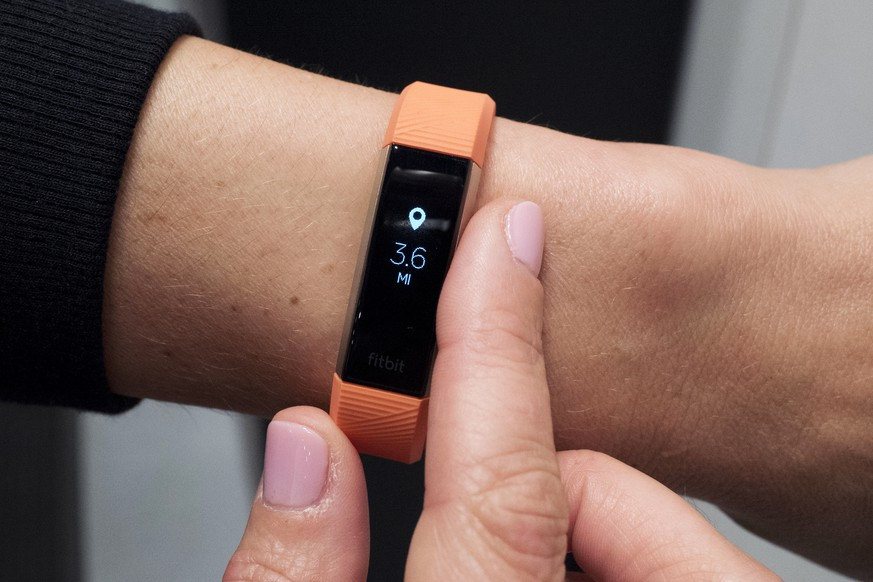 FILE- In this March 1, 2017, file photo, Fitbit's new Alta HR device is displayed in New York. Fitbit Inc. reports financial results on Monday, Feb. 26, 2018. (AP Photo/Mark Lennihan, File)