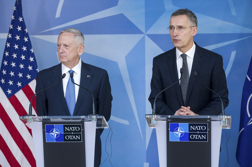epa05794639 US Defence Secretary James Mattis (L) and NATO Secretary General Jens Stoltenberg (R) give a press conference during the NATO Defense Ministers Council at the alliance's headquarters in Brussels, Belgium, 15 February 2017. NATO defense ministers gathered a two-days meeting.  EPA/STEPHANIE LECOCQ