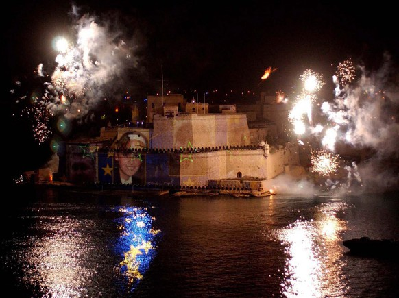 The Valletta Grand harbour is transformed into a light and fireworks show as Fort St. Anglo in the middle of the harbour is the higlight of the midnight show, as Malta  joins the European Union, Saturday 01 May 2004.  EPA/Karl Azzopardi