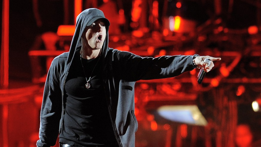 "FILE - In this April 15, 2012 file photo Eminem performs at the 2012 Coachella Valley Music and Arts Festival in Indio, Calif. The music publishers for American rapper Eminem are suing New Zealand's ruling political party over the music it used in a campaign commercial. Eight Mile Style and Martin Affiliated both claim the National Party breached copyright laws by using Eminem's song ""Lose Yourself."" A spokesman for the two companies, Joel Martin, said they filed a case Tuesday, Sept. 16, 2014,  in the New Zealand High Court and are seeking damages.(AP Photo/Chris Pizzello, File)"
