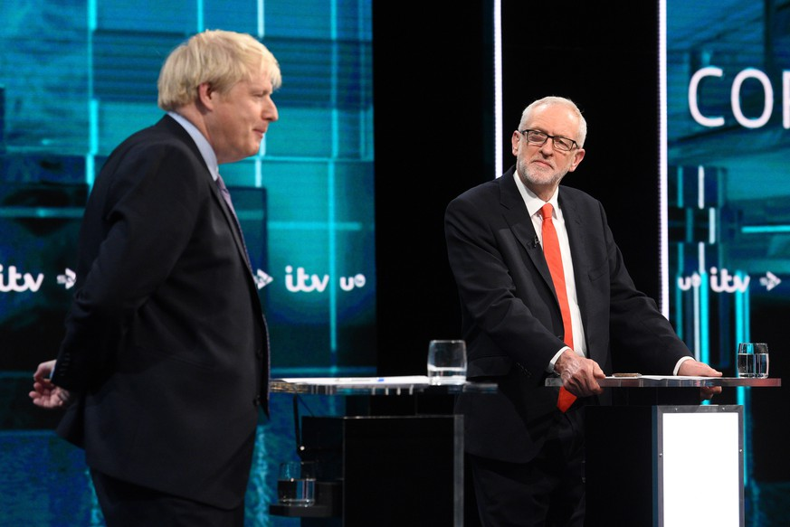 epa08009954 A handout photo made available by ITV shows British Prime Minister and Conservative Party leader Boris Johnson (L) and Labour Party leader Jeremy Corbyn (R) during live debate 'Johnson v Corbyn: The ITV Debate', at ITV Studios in Manchester, Britain, 19 November 2019.  EPA/JONATHAN HORDLE / ITV / HANDOUT MANDATORY CREDIT: JONATHAN HORDLE / ITV EDITORIAL USE ONLY UNTIL 19 DECEMBER 2019 / HANDOUT NO SALES