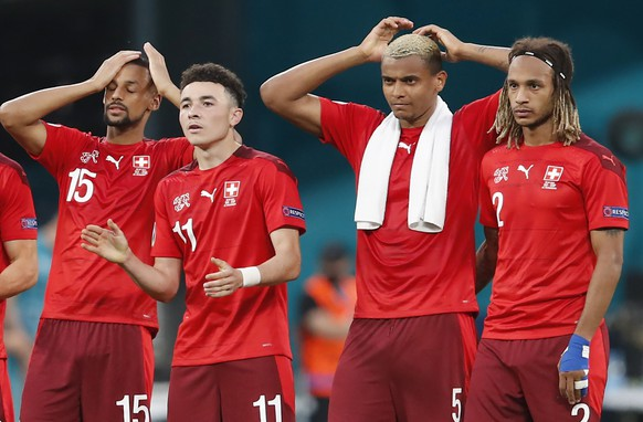 Switzerland players react during the penalty shootout during the Euro 2020 soccer championship quarterfinal match between Switzerland and Spain, at the Saint Petersburg stadium in Saint Petersburg, Friday, July 2, 2021. (Maxim Shemetov /Pool Photo via AP)